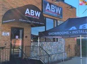 custom storefront canopy awning and panel sign